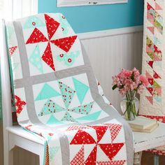 It Takes Two as seen on allpeoplequilt.com. Clever use of flying geese to create pinwheel blocks. I also like the red and aqua combination.