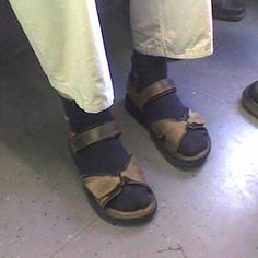 socks and sandals?? how would this even occur to anyone- man OR woman? and why does it continue, generation after generation?! sandals on men in general- questionable at best. flip-flop style only