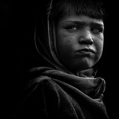 Boy with a face of a man by Faugel, via Flickr