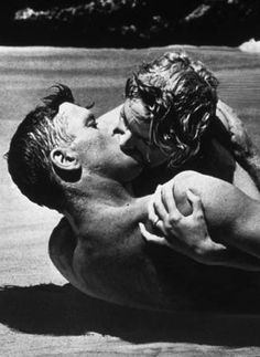 Burt Lancaster and Deborah Kerr in the movie From Here to Eternity  - This clinch was considered at the time to be very naughty! In 2006, a poll of three thousand movie fans voted Deborah Kerr's kiss with Burt Lancaster on a beach in Hawaii as THE most memorable screen kiss.