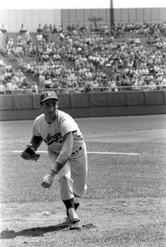 Los Angeles Dodgers pitcher Sandy Koufax in action during a game against the Milwaukee Braves. 1963.