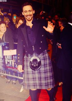 Tom Hiddleston...in a kilt.... <3 He's wearing the same coat as David Tennant did...and I do believe I stopped breathing for a minute or two there...