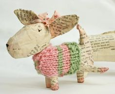 Paper mache dog with knitted coat.