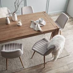 Take your dining room comfort level up a notch by adding these sleek lined chairs! Light Wood Dining Table, Gray Dining Chairs, Fabric Dining Chairs, Wooden Dining Tables, Modern Dining Table, Dining Room Table, Dining Rooms, Wooden Dining Table Designs, Desk Chairs
