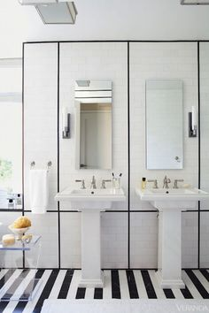 Linear Symmetry. Medicine cabinets, sinks, fittings, T, Kohler. Marble tile, Ann Sacks. Mirror and sconces, Robern.  Image originally appeared in the January/ February 2021 issue of Veranda.