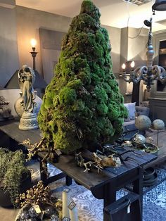 Yule style!!! Fabulous Moss Christmas tree with old gnarled gray branches at the base!! Cool and different for any home, store or restaurant! Display Window Idea!