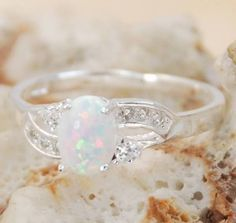 Diamond Wedding Rings : WHITE FIRE OPAL instead of a diamond for an engagement ring! - Buy Me Diamond Opal Jewelry, Jewelry Rings, Jewelery, Jewelry Accessories, Pretty Rings, Beautiful Rings, Bling Bling, Opal Edelstein, White Opal Ring