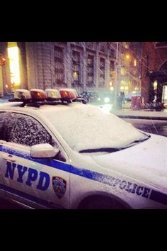 New York police car in the snow