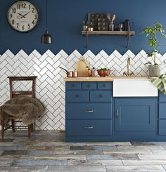 Herringbone tiles kitchen splashback - more interesting than standard brick pattern. Home staging - Kitchen