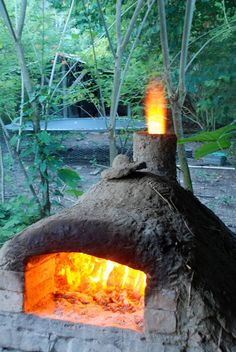 Homemade brick oven made with mud, bottles, and bricks. Maybe that outdoor oven I've always wanted is affordable after all!