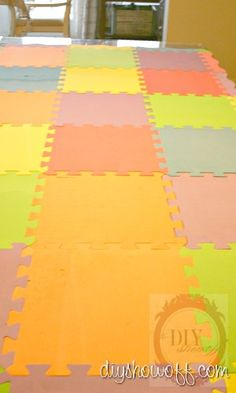 @Nicole Goeking; Check out this link to see how a playmat like this is transformed into a painted rug! playmat.tutorial01