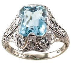 Bailey Banks & Biddle Art Deco Aquamarine Diamond Platinum Ring.  A lovely treasure from the past to grace the finger of a fortunate lady. The ring is very pristine, not to mention beautiful. The Art Deco platinum mount showcasing an emerald-cut aquamarine endowed with good blue color and brightness, framed within a graceful array of diamonds denoted by crisp geometric lines, mile-grain and chase work along the shank...c 1925