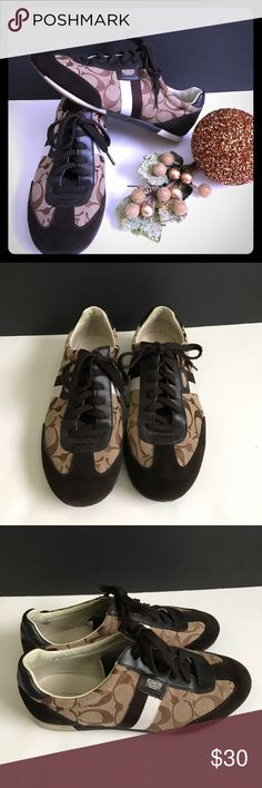 COACH T SHOES COACH T SHOES In very good condition, brown color , C  written all over, brown suede in front of shoe and back. Coach Shoes Sneakers
