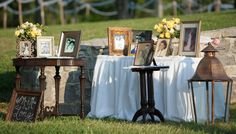 Vintage table  displaying pictures of the bride and grooms parents, grandparents and great grandparents.