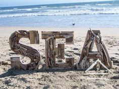 Ocean Sea: Driftwood letters rise from the sand. Ocean Beach, Beach Bum, Glamping, Tropical, Thing 1, I Love The Beach, Beach Signs, Driftwood Art, Beach Crafts