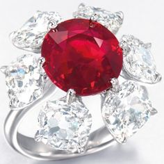 """6.04-carat Burmese ruby and diamond ring by Etcetera with an estimate of $2.5 million – $3.8 million. This cushion-shaped stone that hasn't been treated with heat possesses the most desirable """"pigeon's blood red"""" color and and an extraordinary degree of transparency"""