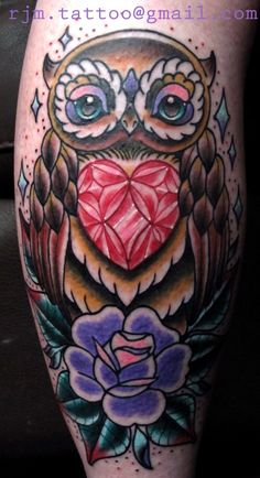 owl diamond tattoo - a bit much around the edges, but a pretty design.
