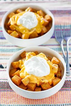Taco Bell Cheesy Fiesta Potatoes are crispy, spicy, and topped with nacho cheese and sour cream. Get the easy copycat recipe and find out how to make the best Mexican potatoes at home. Perfectly seasoned and deep-fried, these potatoes are great for vegetarian tacos, burritos, or simply as a side dish in a bowl! #mexicanfood #tacobell #potatoes #copycat #copycatrecipes