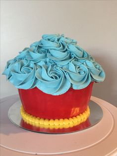 Smash cake. Paw patrol colours. 1st birthday photo shoot. Red fondant, blue and yellow buttercream. Custom Creations Sudbury customcreationsudbury@gmail.com Find me on Facebook