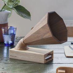 A beautiful handcrafted wooden amplifier that acts as a speaker for any iPhone. The wood naturally amplifies the iPhone\'s own speakers, adding a warmth to the sound. The design cleverly combines retro and modern styling, making it a beautiful addition to any space and a great unique gift for music lovers.