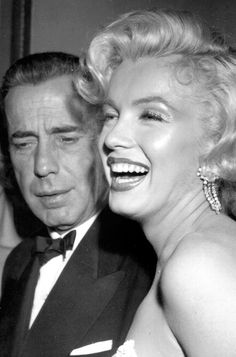 Humphrey Bogart & Marilyn Monroe photographed by Earl Leaf at the premiere of 'How To Marry A Millionaire' in Los Angeles ~ November 4, 1953
