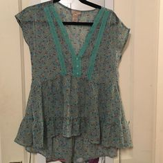 Festival Chic! Floral sheer top! Eyelash mint green sheer top with flowers. Hangs lower in the back and ties in the back for more fitted look. Perfect for upcoming festival season! Tops
