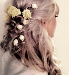 Roses, curls, and baby's breath.