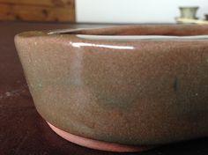 Conception et fabrication de pot bonsai , bol de fruit  , bol de laine  et tasse en céramique poterie fabriquer à partir d'argile et d'un tour à potier , et cuisson au four à céramique