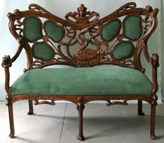 Calry & Co. Antiques (NY). Art Nouveau hand carved wood faux bois and figural upholstered settee, c. 1880, with carved maidens heads,elaborate swan, and shamrocks- all surrounded by a curving vine frame.  An unusually fine example in superb, carefully restored condition, recently upholstered.  Unsigned, of American or French origin. $ 22,500.(http://antiques.malleries.com/art-nouveau-carved-settee-i-8873-s-130.html?mall1SID=9f263020495987df8ac33dfa5af45a4b).