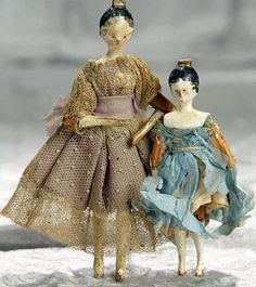 4 - 5.6 Inches early Grodnertal wooden dolls in dollhouse size, known as Tuck Comb Dolls.
