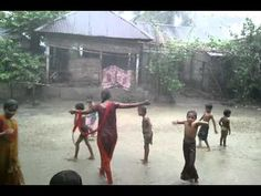 Bangladesh Village kids playing in the rain