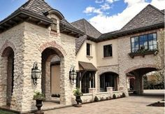 """Coronado Stone French Country Villa Stone in """"Versailles"""" with mortar wash. I love the use of the stone, brick accents, bronze standing seam metal canopy and the roof. French Country Exterior, French Country Bedrooms, French Country House, Country Chic, Stone Exterior Houses, Dream House Exterior, Stone Houses, Austin Stone Exterior, Coronado Stone"""