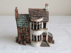 Pottery houses produced by Melvin Griffin in 1989. Purchased in Dunster, England.