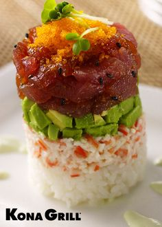 Tuna tower. one of my favorite things at kona grill. yyyyyummmmmm  i lurv sushi.  Rice, crab mix, avacado, tuna w/ tartare sauce, topped with masago, drizzled with wasabi aioli.  I can't not get this when go.