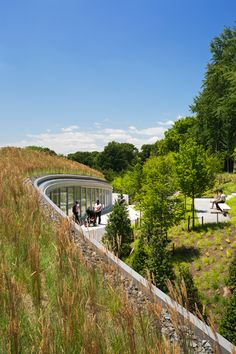 New York City's Brooklyn Botanic Garden visitor center is a seamless extension of the landscape. Nested into an existing berm, the center is experienced as a three dimensional continuation of the garden path system, framing a series of views into and through the garden. Click for details via Weiss/Manfredi Architects, and visit the Slow Ottawa 'Consume Less' board for more sustainable initiatives.