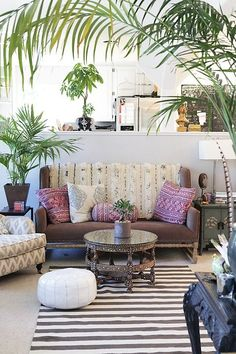 Enjoy cocktails and the view at the Boho Beach Lounge at Canyon Ranch -- we'll come for the cocktails, but stay for the elegant bohemian global-chic style. Can't get over the Moroccan pouf, vintage kilim pillows, striped rug and indoor palms. Love!