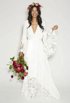 For the free-spirited bride who doesn't believe in sacrificing comfort for style, a vintage-inspired robe gown is sure to bring you the best of both worlds.