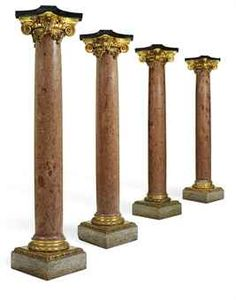 A SET OF FOUR FRENCH ORMOLU-MOUNTED PORPHYRY AND GRANITE COLUMNS