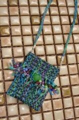 treasure bag necklace from window screen