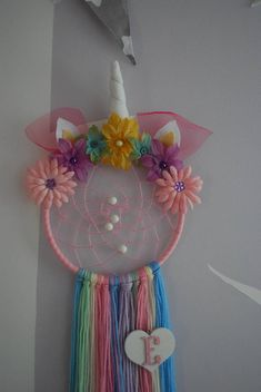Made to order unicorn dream catcher with your choice of ribbon colour and initial. A perfect addiction to any room where a little magic is required. The webbing and beads will help to trap the bad dreams while the hole in the middle allows the good dreams to reach the dreamer below.