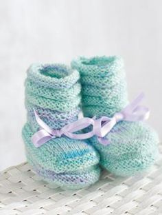 """Free Pattern Baby Booties: All you need to know is how to knit and purl and you'll have these pretty baby booties done in no time. The lovely colors of """"My first Regia"""" color and the matching satin ribbon make them an instant heirloom. Simply adorable!"""