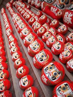Daruma dolls - Daruma dolls are seen as a symbol of perseverance and good luck in Japan. When first received, they have no eyes. The owner paints one eye in and sets a goal, the other eye is painted when the goal has been achieved.