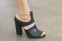 PROENZA SCHOULER. Spring/Summer 2015. What did work particularly well were the accessories. The designers had some stellar footwear this season. Their fringe topped sandals, open toed boots and metal bracelet ankle wrapped heels all should sell out in seconds.  (As cited from nowfashion.com) #ProenzaSchouler #Proenza #Schouler #newcollection #ss #heels #OnwardLuxuryGroup #OLG