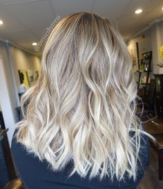 Blonde balayage textured bob with beach waves