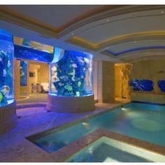 omg indoor pool with aquariums in walls <3