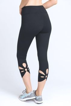 0c57ce701cbc98 Flower power capri leggings have a hexagon design with an array of colors  including black, turquoise, orange, white, yellow and magenta.