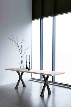 The Exe #dining_table, book matched #Elm top and patinated steel base.