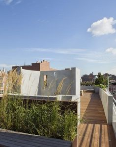 For this expansive outdoor rooftop space in the East Village by Pulltab A+D (members of the Remodelista Architect/Designer Directory), the architects were tasked with maximizing the panoramic views while maintaining a sense of privacy, which they achieved via strategically placed walls, canvas screens, and plantings. Photos by Bilyana Dimitrova, courtesy of Pulltab A+D.