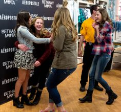 (Trent Nelson     The Salt Lake Tribune)  Kaylie Ross, Maren Pilcher and Jessica Brroks rush in to meet YouTube star Bethany Mota, at the Aeropostale store in Fashion Place Mall in Murray where she opened a new line of clothing Thursday February 13, 2014.