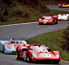 1970 .. Nurburgring 1000km , Joe Siffert in the No.20 J.W.Porsche 908/3 , getting annoyed by the slower Ferrari 512S Spyder of I .Giunti , both retired with engine problems .